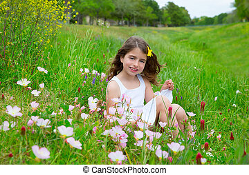 children cute girl on spring meadow with poppy flowers -...