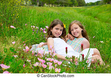 children friends girls on spring poppy flowers meadow -...