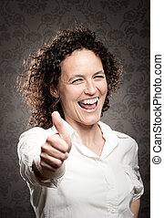 woman giving a thumbs up sign - happy business woman giving...