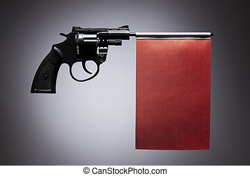 Gun crime concept of hand pistol showing a blank red flag