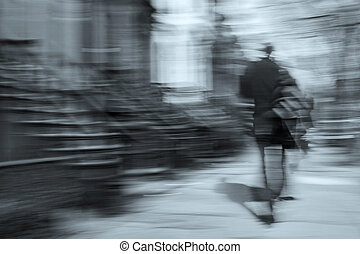 man walking motion blur - man walking on a city street in...