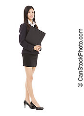 full length smiling businesswoman holding folder