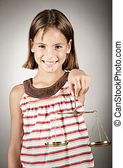 girl holding justice scale - little girl holding justice...