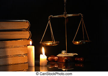 Scales Of Justice - Old brass weight scale and books near...