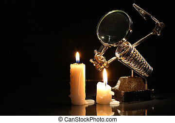 Magnifying Glass And Candles