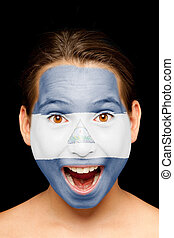 girl with nicaraguan flag on her face - portrait of girl...