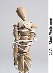 Tied up in technology - Artist mannequin tangled with a...