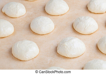 Small balls of fresh homemade pizza dough - Small balls of...