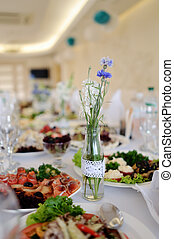 banquet table with different gastronomic dinner