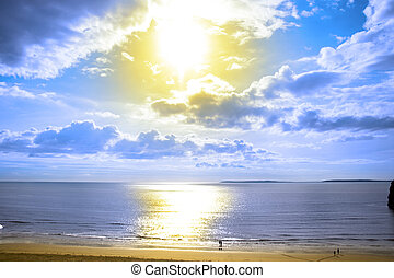 tourists walking on Ballybunion beach at sundown - tourists...