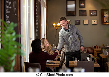 Young Man in Cafe Introducing Himself - Young man in cafe...