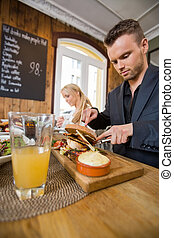 Businessman Having Food With Colleague