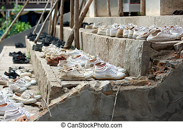 school children`s shoes outside of temple