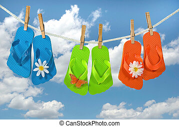 colorful flip-flops on clothesline - Bright colored...