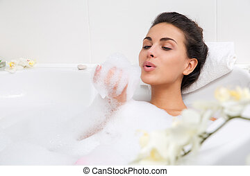 beautiful young woman takes bubble bath - young beautiful...