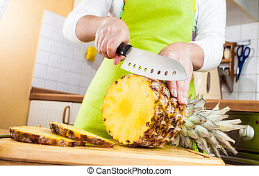 Womans hands cutting pineapple - Womans hands cutting fresh...