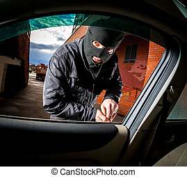 Car thief in a mask. - Robber and the car thief in a mask...