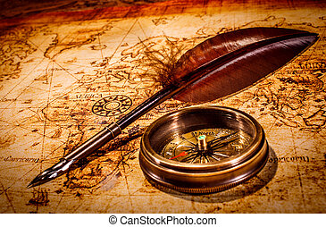 Vintage items on ancient map. - Vintage magnifying glass and...
