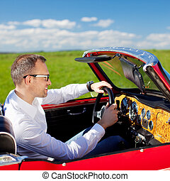 Man in convertible car - Young man driving with his red...