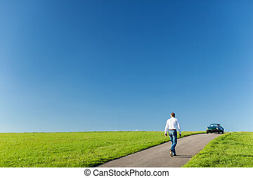 Man walking towards his cabriolet - Man walking along a...