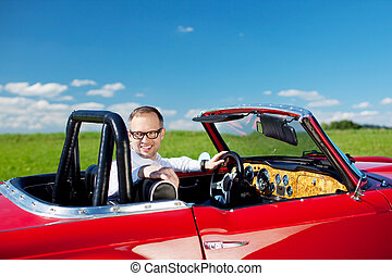Happy man relaxing in his cabriolet - Happy man relaxing in...