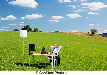 Relaxing businessperson - Businessperson relaxing with chair...