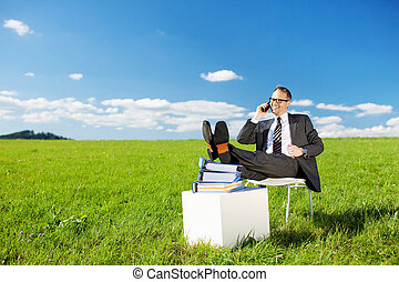 Business concept shot of businessman calling with his feet...