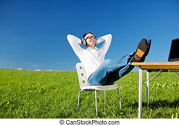 Businessman with headset - Young businessman relaxing with...