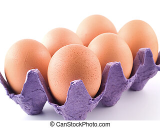 Brown Eggs in a Carton 1 - Six Brown Eggs in a purple carton...
