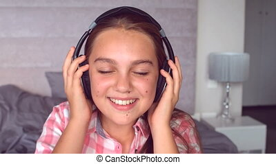 Girl listening to music with headphone in slow motion at 500...