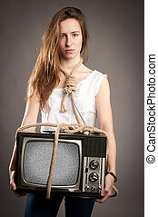 girl holding retro television - young girl with rope holding...