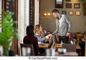 Woman Shaking Hands With Male Friend - Young woman shaking...