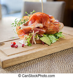 Parma Ham Sandwich On Wooden Plate - Delicious parma ham...