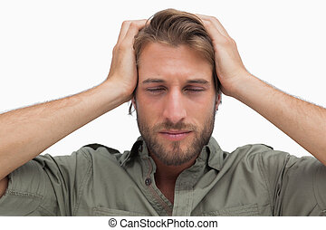 Exhausted man with hands on head on white background