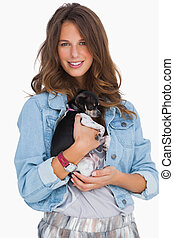Smiling woman with her chihuahua on white background