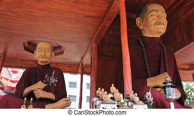 Two Oversized Monk Statues - Two oversized Buddhist monk...