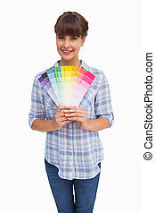 Happy woman with fringe showing colour charts