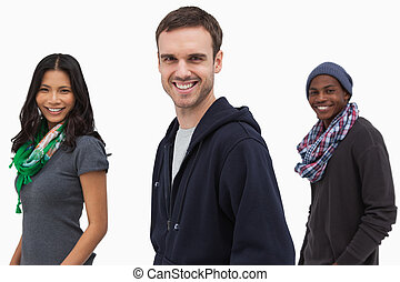Happy stylish young people in a line on white background