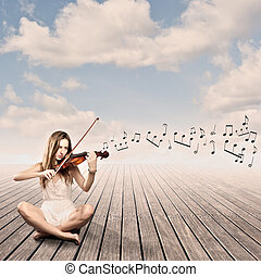 little girl playing violin on a wharf