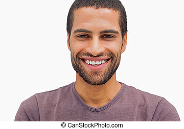 Handsome man smiling on white background