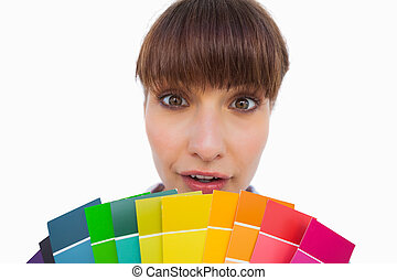 Pretty woman with fringe showing color charts close up