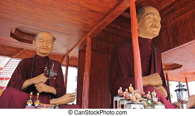 Oversized Monk Statues In Temple - Two oversized Buddhist...