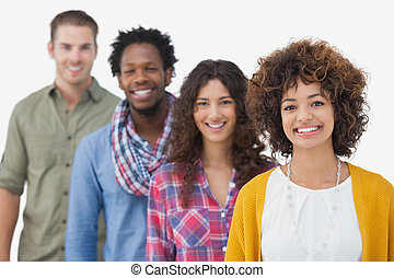 Four stylish friends smiling at camera on white background