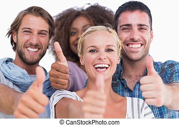 Happy group giving thumbs up on white background