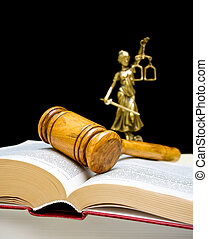 gavel on law book on a black background. vertical photo. -...