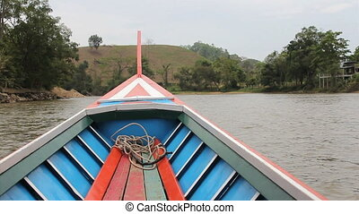 Long Tail Boat On River In Thailand - A long tail boat...