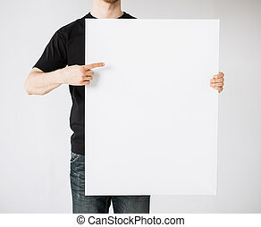 man with blank white board - close up of man hands showing...