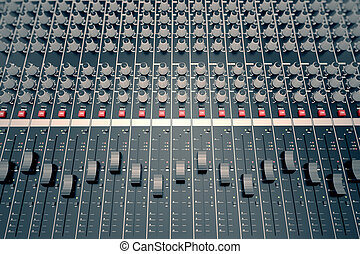 Audio Console. - Top shot of a mixing console, equipped in...