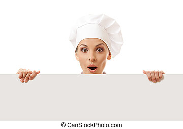Woman cook looking over paper sign billboard Isolated on...