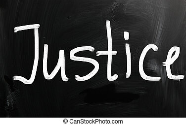 """The word """"Justice"""" handwritten with white chalk on a blackboard"""